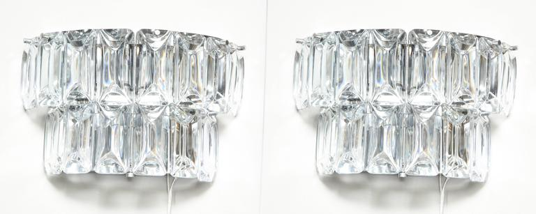 Modern Austrian crystal sconces.