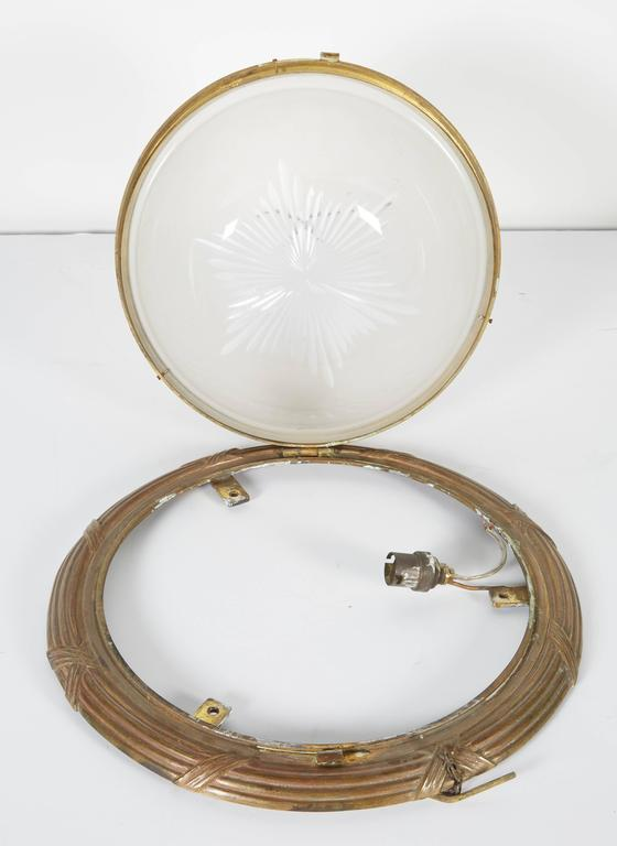 A pair of flush mount ceiling lights with cut-glass bowl. Single lamp. Hardware is not included.  Not available for sale or to ship in the state of California.
