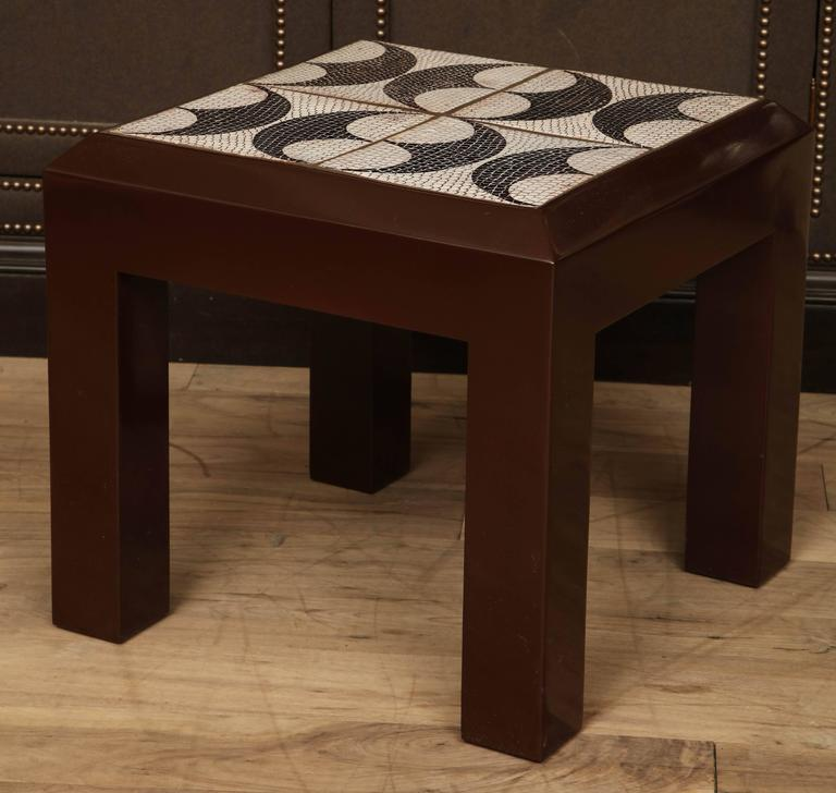 Lacquered maple side table with inset tile top with black and white fish scale and shield pattern, circa 1950.
