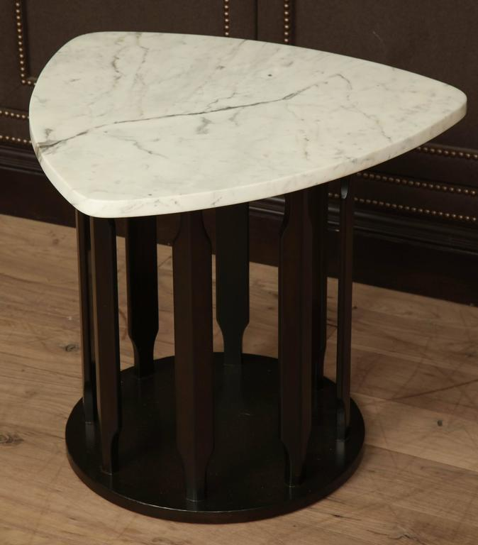 Dark sable finished side table with triangular marble top, circa 1950.