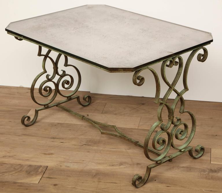 Iron side table with verdigris and antique mirror top, circa 1950.