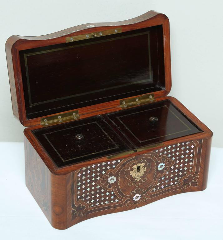 Fashioned with a mother-of-pearl inlaid dome form lid. Superior detail with inlaid brass embellishments.