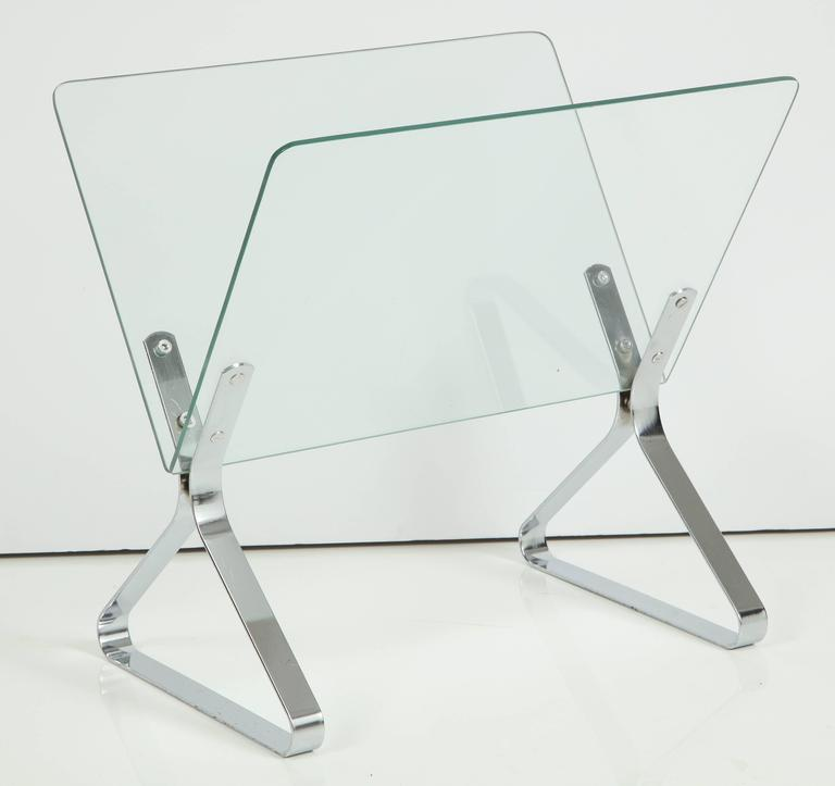 Magazine stand designed by Milo Baughman, circa 1960. Glass with polished chrome details.
