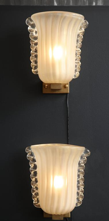 These rare pair of Italian sconces are a piece of art. Handblown and handcrafted as only the Italian masters can do. Ivory colored glass (handmade from Italian silica sand) infused with 23-carat