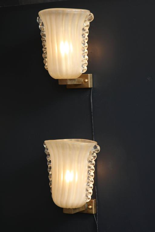 Mid-Century Modern Pair of Italian Ivory with Infused Gold Murano Glass and Brass Sconces For Sale