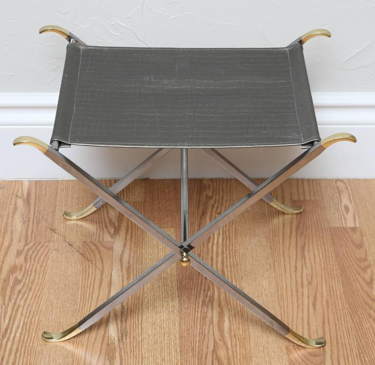 Pair of folding steel and brass Campaign stools with faux crocodile seats.