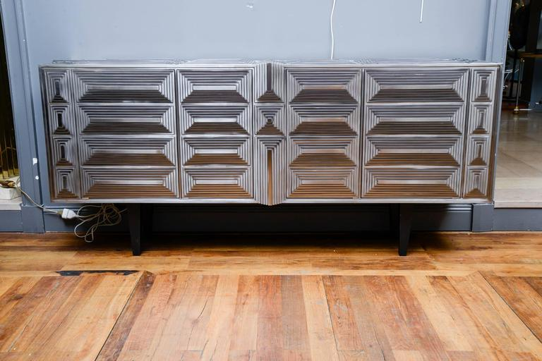 Sideboard by Erwan Boulloud in stainless steel, pyramid-shaped sculpture, four doors, shelves inside.