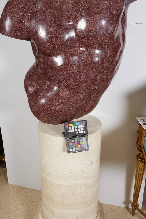 An Italian porphyry veneered model of a torso, after the antique by Anthony Redmile on marble-veneered pedestal.  20th century.  Sitting on a marble veneered pedestal turning 360 degrees.  Measures: 30.5