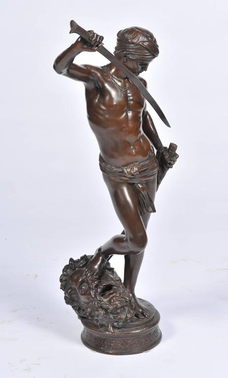 A very good quality bronze statue of David having defeated Goliath, standing over Goliath's head. Jean-Antonin Mercie, (French 1845-1916)