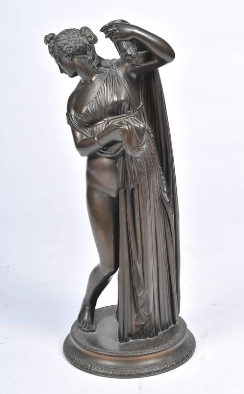 A very good quality 19th century bronze statue of a female nude, semi clad in robes. Having a good patination and signed; M. Amodia. Napoli, 1880.
