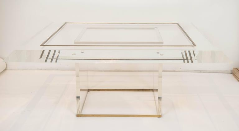 "This impressive coffee table measures 43"" square by 18"" high and is adorned with brass overlay on the base and tabletop. The top is 3"" thick acrylic with a generous bevel whilst the base is 1"" thick acrylic. The two pieces are not attached."