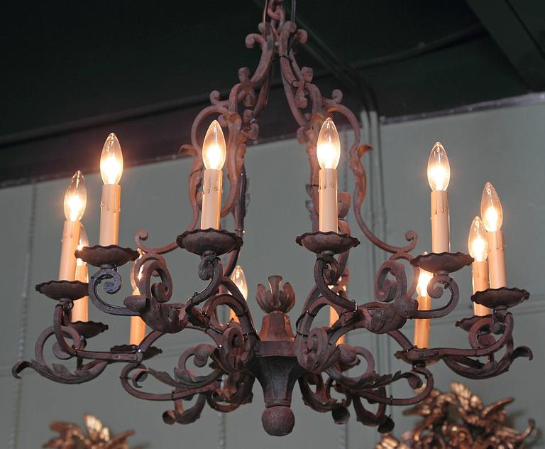 Hand-Painted Early 20th Century French Verdigris Ten-Light Iron Chandelier For Sale