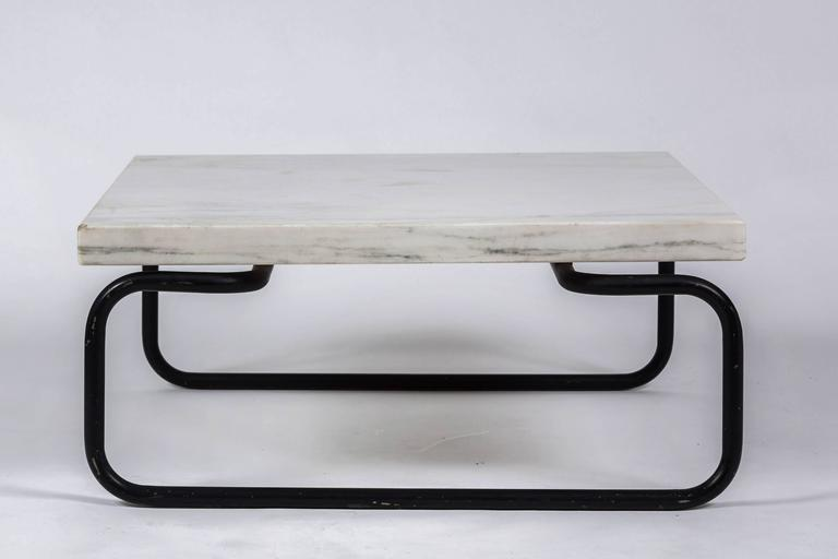 White marble cocktail or coffee table by Cassina with black metal tubular base. Designed by Michael McCarthy for Cassina, 1960s.