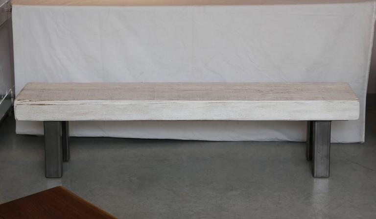 This bench is handcrafted by a Floridian artist, we can custom your order.  The material is cedar,which is lightweight wood and impervious to insects. Finish is a clear sealer which will not yellow over time.  It is possible to put the bench outside