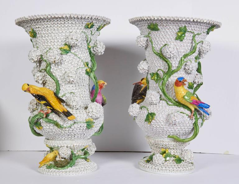 This rare and monumental antique pair of Meissen Porcelain 22 inch vases is crafted in the illustrious Schneeballen, or Snowball, pattern. First modeled by the famed Johann Joachim Kændler in 1741, these magnificent vases are covered with hundreds