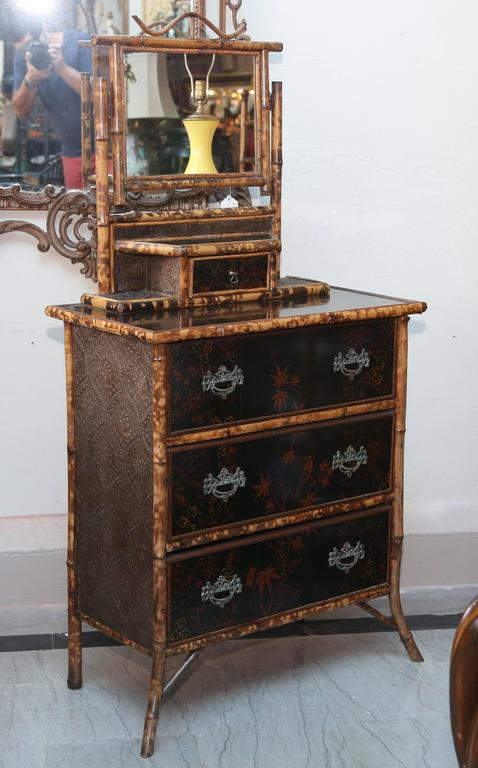 Appointed with a chinoiserie lacquered top. Nicely detailed and fashioned.