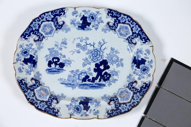 Chinoiserie ironstone platter, Ridgway & Morley, England, circa 1845. A beautifully articulated transferware design with shades of blue, and gold border and accents. Ridgeway & Morley was a major manufacturer in Staffordshire, England. Retains an