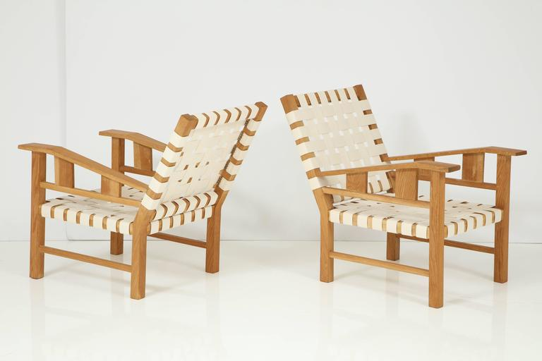 Natural oak armchairs by Francis Jourdain, new cotton strap webbing. Cushions can be made on request. Two pairs are available. Price for one pair.