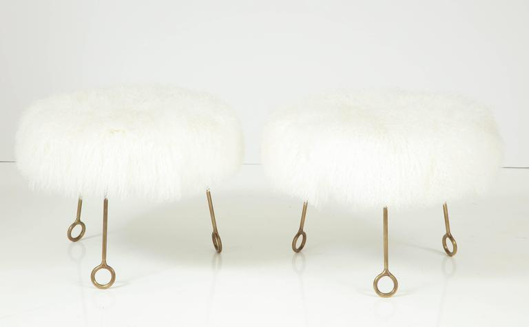 Gorgeous pair of Jean Royère attributed Yoyo stools in brass and sheep skin.