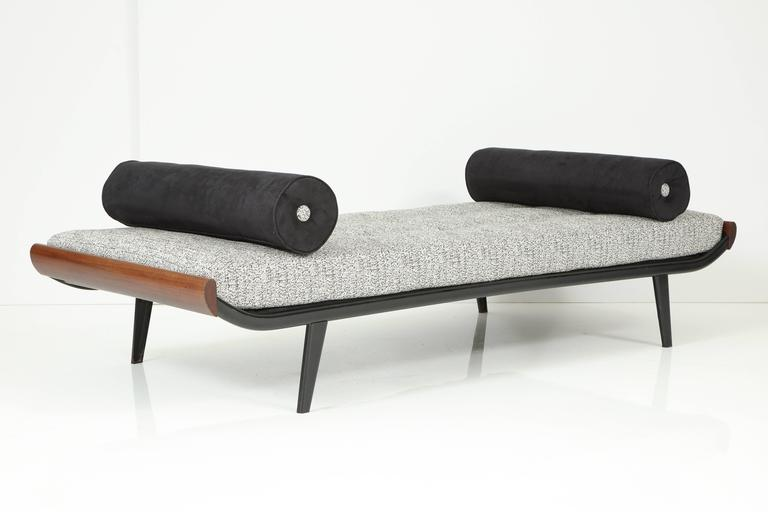 Newly upholstered Cleopatra daybed, black enameled frame with teak wood end caps. pair available.