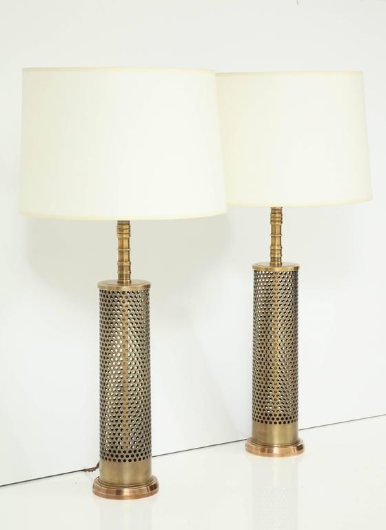 Elegant and heavy bronze and brass table lamps, refinished and rewired.
