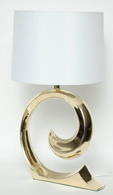 """Iconic pair of polished brass """"swoosh"""" lamps by Pierre Cardin. Lamps have been mint restored with new brass plating and new wiring for use in the USA. Shades not included."""