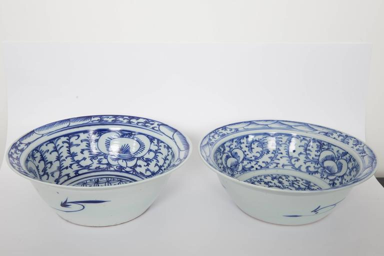 Pair of Chinese blue and white flared rim bowls on handmade wooden stands.