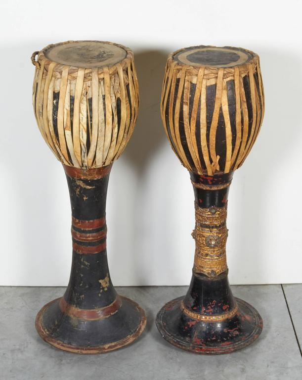 Two striking and well decorated hill tribe drums from northern Thailand. The attractive patina of these drums shows years of use in ceremonies by the hill tribes along the border between Burma and Thailand. Only one piece available. RIGHT drum in