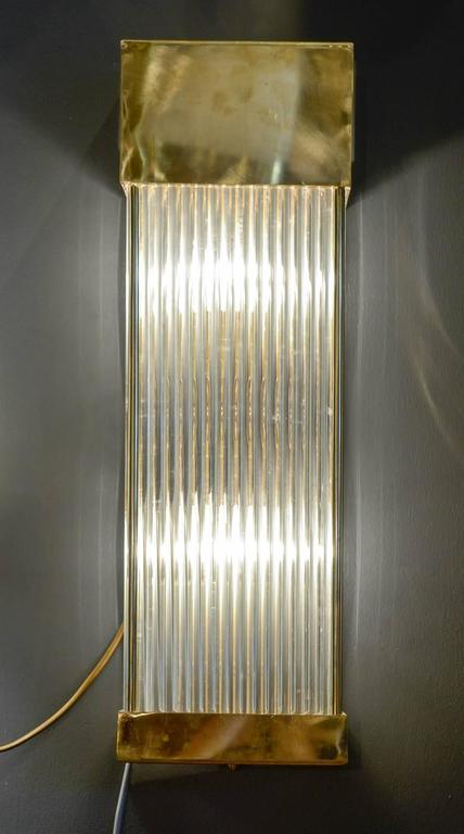Set of six wall sconces made of glass rods set in a brass cage.  Two lights per sconce.  Price for the set.