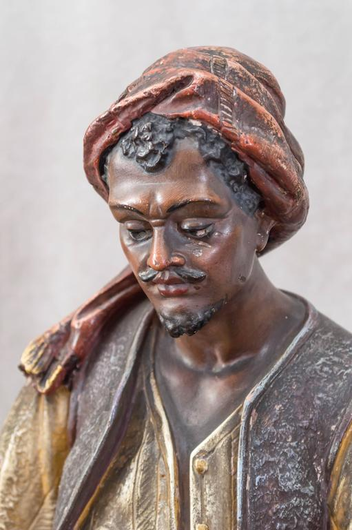 Austrian Large Plaster Sculpture of an Arab Merchant Holding a Tray For Sale