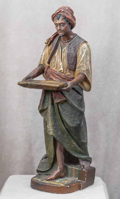 Large Plaster Sculpture of an Arab Merchant Holding a Tray In Good Condition For Sale In San Francisco, CA
