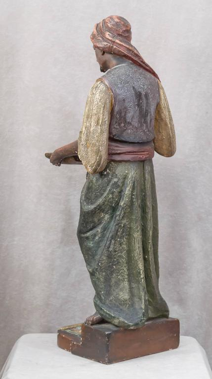 Large Plaster Sculpture of an Arab Merchant Holding a Tray For Sale 1