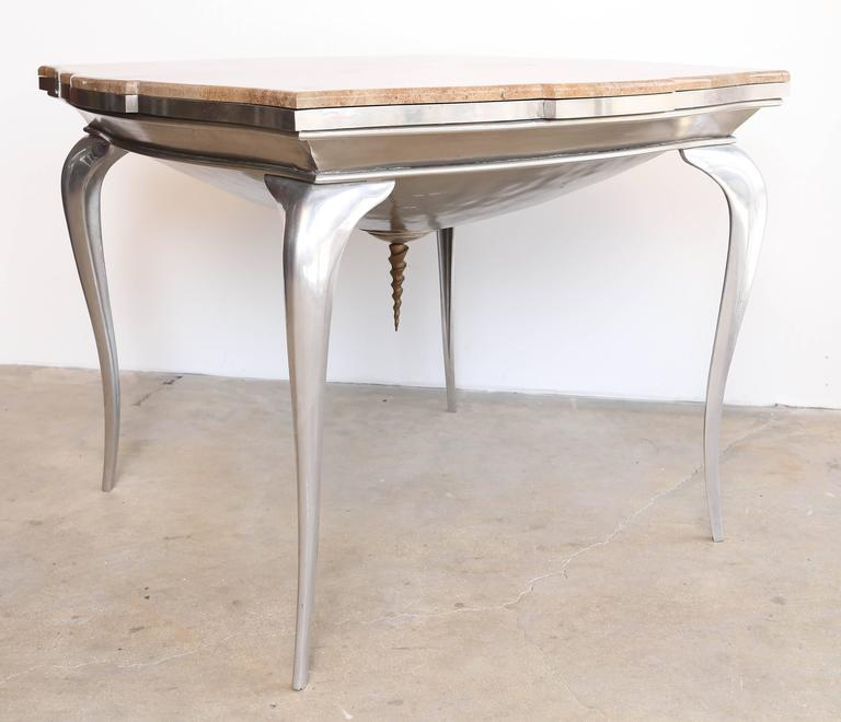 Brazier Jones is an international creator, master in furnitures and lightening designer. Some of his work of art are displayed in The Victoria and Albert Museum in London . He is inspired by the Futuristic surrealist Movement and neoclassical