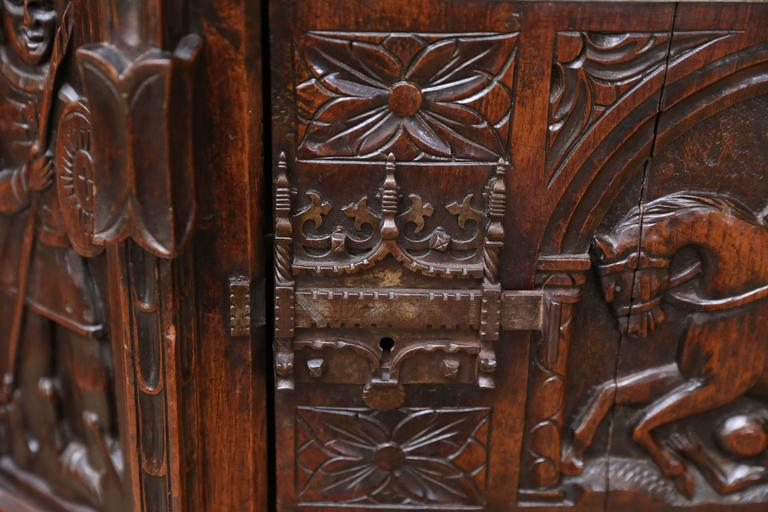 Spanish Oak Cabinet, Early 19th Century Carved with a Rider and a Horse 1