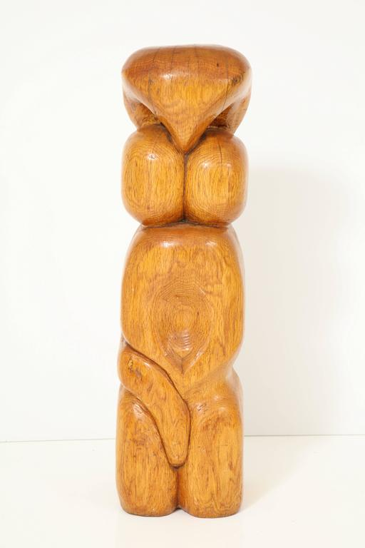 Midcentury wood carving, seems to represent a female figure. Oregon pine.