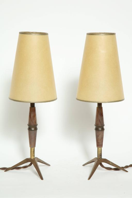 Elegant pair of brass and bakelite table lamps, ideal for a bedside or an accent lamp.