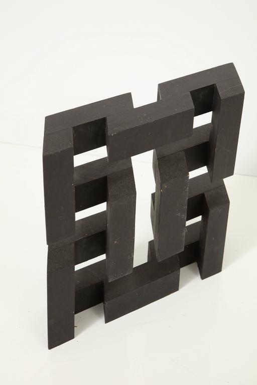 Blackened pine wood sculpture.