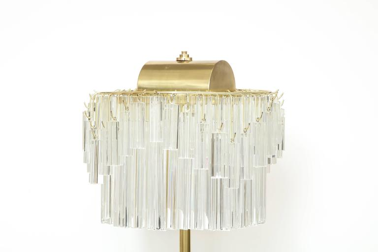 Venini crystal triedi prism floor lamp. Crystal body supported by a brass pole and white marble base. Floor lamp utilizes six light sources using candelabra type bulbs. Rewired for use in the USA. Originally a special order and sold thru Camer