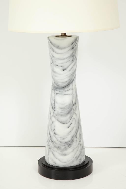 Corset form grey cloud marble table lamp with ebonized oak stepped base, circa 1960.
