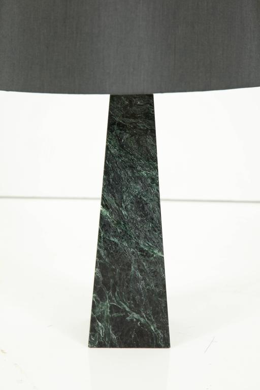 Green marble obelisk desk lamp with bronze finished hardware and charcoal silk shade, circa 1960.