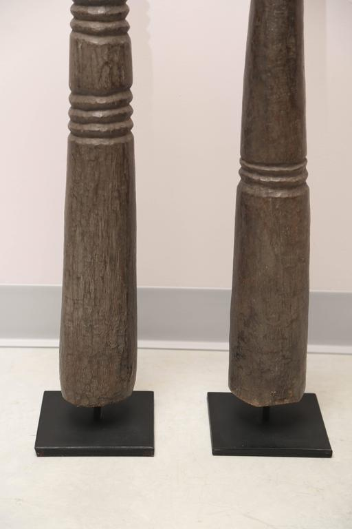 This is the first time that I have seen this kind of African carving, to the point that I cannot positively identify the origins they are a heavy and super solid African wood. It would be a great addition to a very contemporary, Minimalist setting.