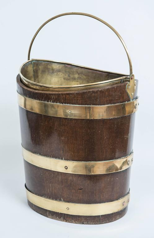 A Classic oval wooden peat bucket in
