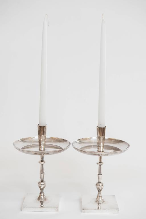 Add style and sophistication to your table with this impressive pair of single candle holders designed by Tommi Parzinger. Stamped HEIRLOOM