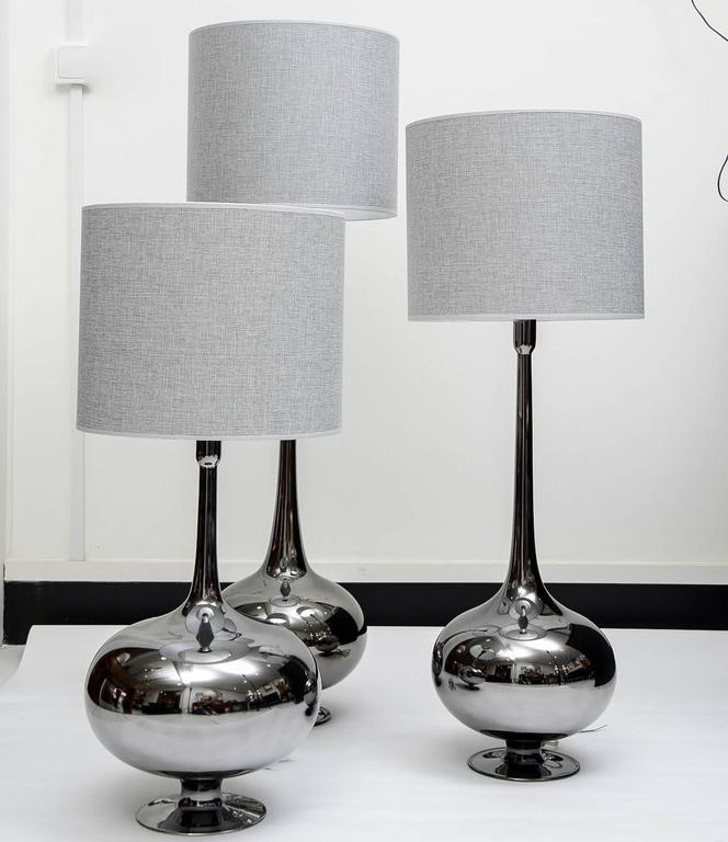 Set of table lamps in glass. Titanium finishing. Three different sizes: 69 cm, 82 cm, 98 cm