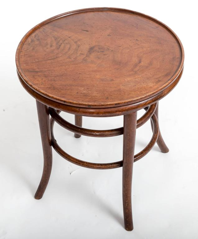 Small side table perfect height for one side of an armchair, splayed legs, two double round stretchers.