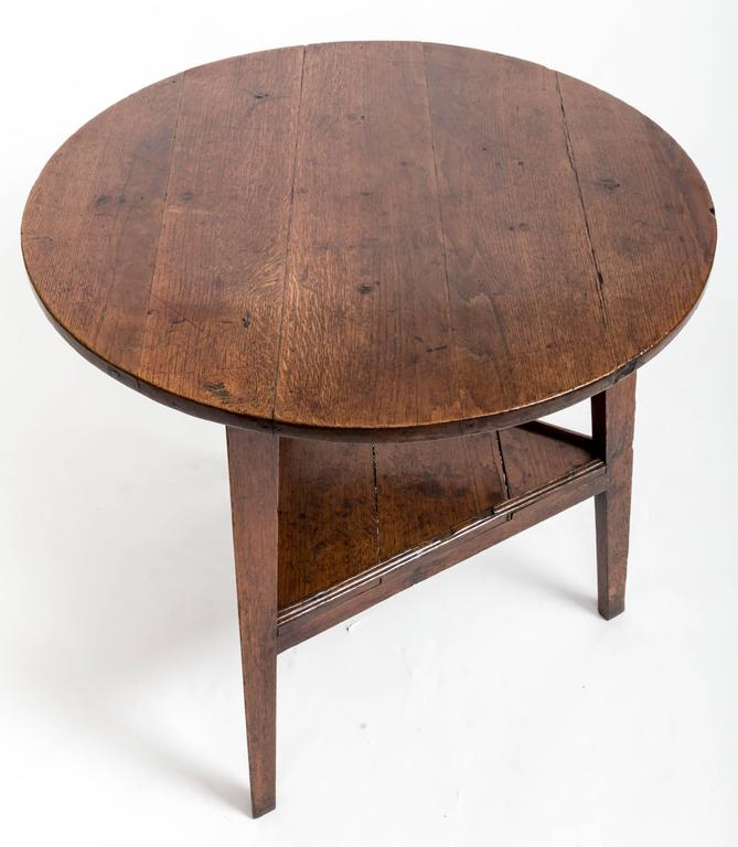 Classic cricket table with three tapered legs, second pot shelf.