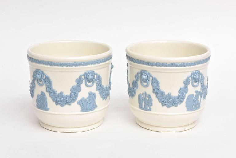 A darling pair of turquoise on a creamy white color porcelain