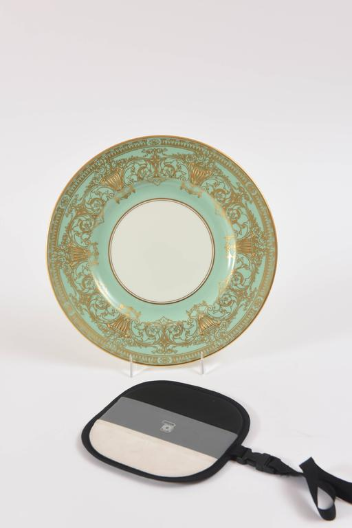 What a pretty shade of turquoise or sea foam green! From the storied English firm of Royal Worcester, these unique plates feature beautiful raised paste gilding on a soft aqua collar. Perfect for mixing and matching in with all your fine porcelain