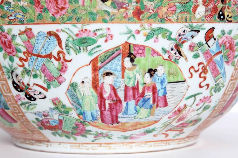A large 'Canton Famille Rose' punch bowl in the 'Rose Medallion' pattern with panels of Chinese garden scenes and Chinese ladies within numerous borders, repeated inside Measures: 16 in. diameter