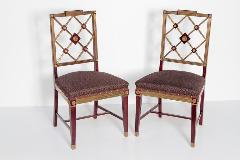 A pair of Russian Empire neoclassical side chairs, mahogany with fluted brass mouldings and fittings, the backs of joined latticework design with tight seats in dark chocolate brown horsehair upholstery with spaced nail-heads and trim. Imperial